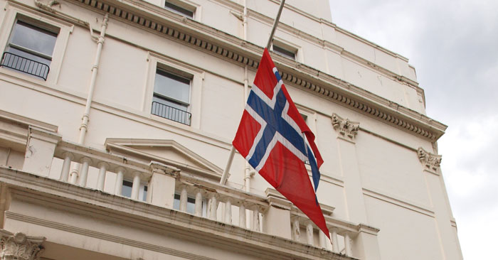 The Norwegian flag flies at half-mast and flowers have been placed at the door of the Norwegian Embassy. -- Following the blast in Oslo and Utoeya island shooting, the flag at the Norwegian Embassy in London flies at half-mast. London, UK. 23 July 2011